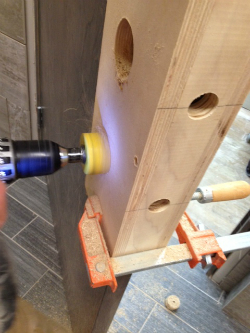 Drill through bore holes on the other side of the door.
